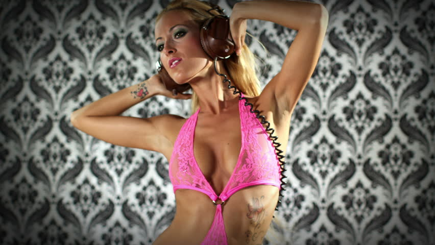 sexy professional gogo studio shoot dancing and posing in pink costume - HD stock video clip