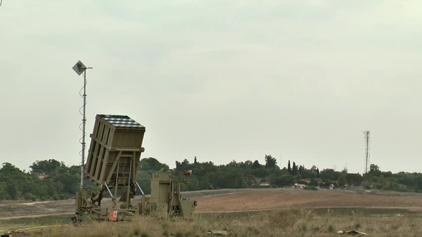 up close shot of an Iron Dome system launches three interceptors. morning, rural area.