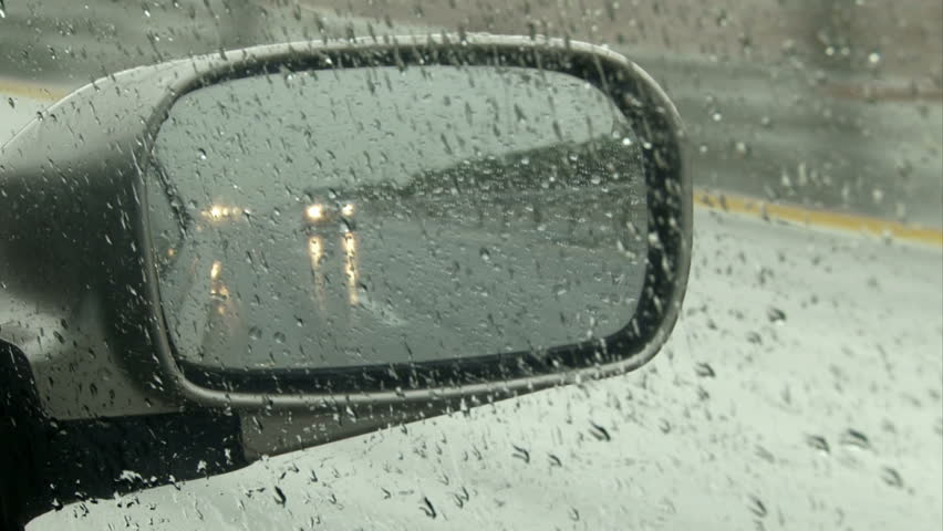 Car right mirror detail Point of View. Driving on a rainy day on highway. - HD stock video clip