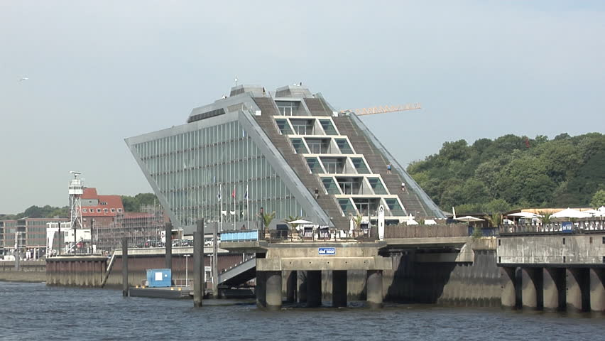 HAMBURG, GERMANY - AUGUST 01: Passing the Dockland house on the waterside. The office building was created by famous architect Hadi Teherani.  - HD stock video clip