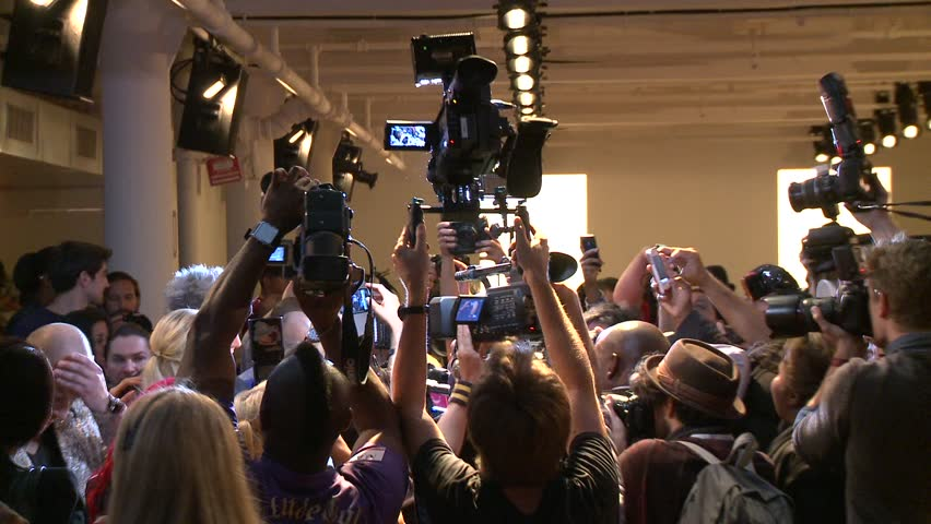 NEW YORK - SEPTEMBER 11: Photographers crowd shooting celebrities before the runway at the Blonds Collection for Spring/ Summer 2013 during Mercedes-Benz NY Fashion Week on September 11, 2012 in NYC - HD stock footage clip