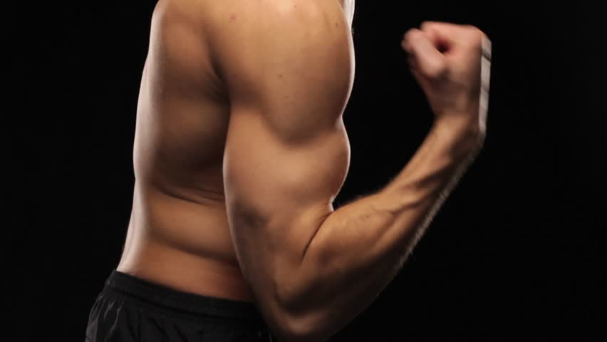 Side view of man doing arm lifts - HD stock video clip