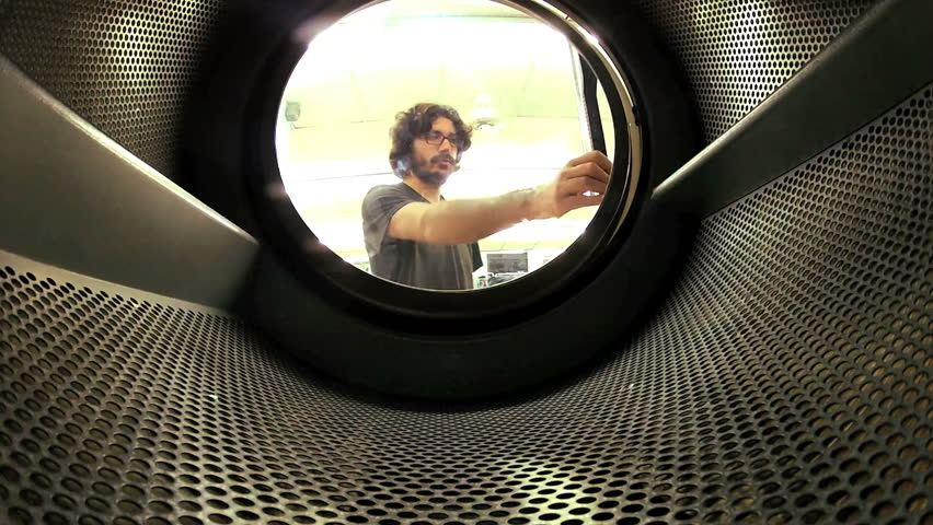 Man does laundry - Shot from inside washing machine - HD stock footage clip