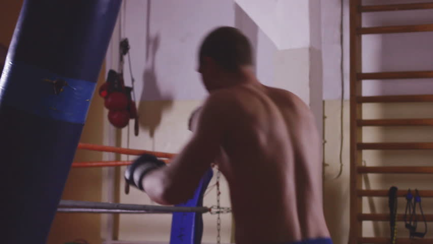 Young boxer trains on punching bag