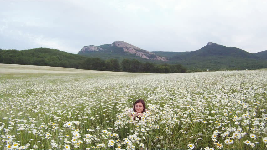 Woman Laying Among Daisies In A Field. Stock Footage Video ...
