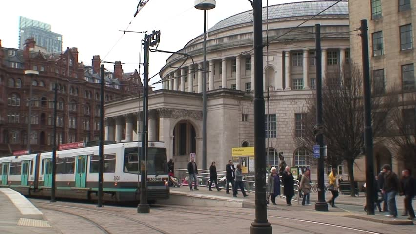 MANCHESTER, UNITED KINGDOM - CIRCA 2011: Manchester Metrolink trams departs St Peter's Square station in front of the Central Library.