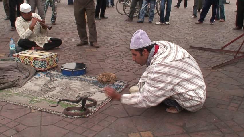MARRAKECH, MOROCCO - CIRCA 2007: Snake charmer Marrackech Morocco