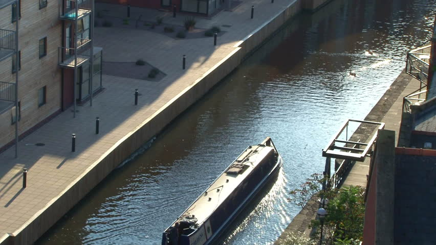 MACHESTER, ENGLAND - CIRCA 2011: Canal boat on the Ashton Canal through Manchester.