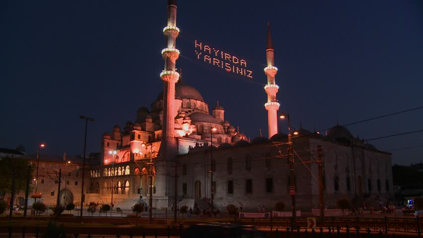 ISTANBUL, TURKEY 2012 A tram passes in front of a mosque in istanbul, Turkey at night. - HD stock footage clip
