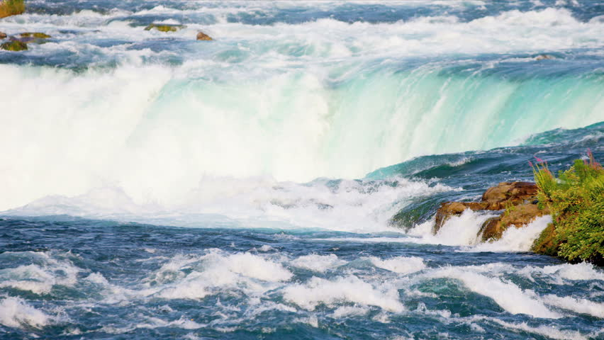 Fast moving water flowing over Niagara Falls, USA Canadian border