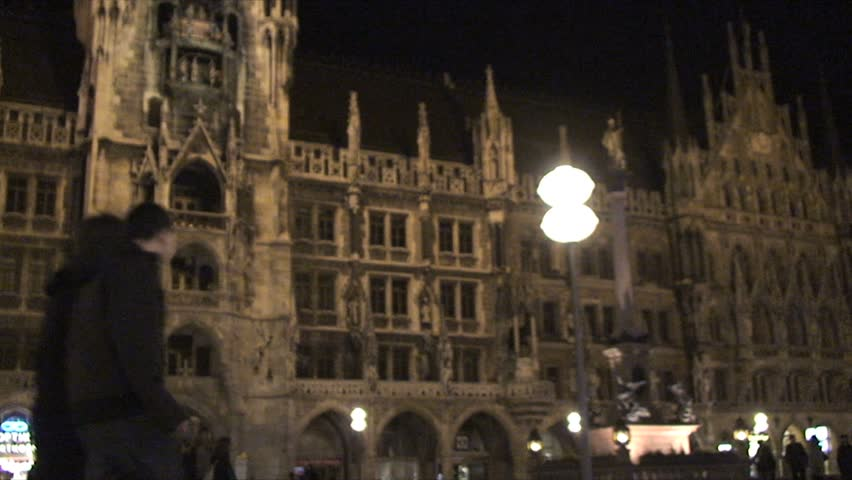 March 1, 2008 - Munich, Germany - Marienplatz Square at night Germany with People - Panning - HD stock video clip