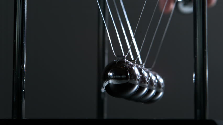 Newtons cradle in motion in slow motion