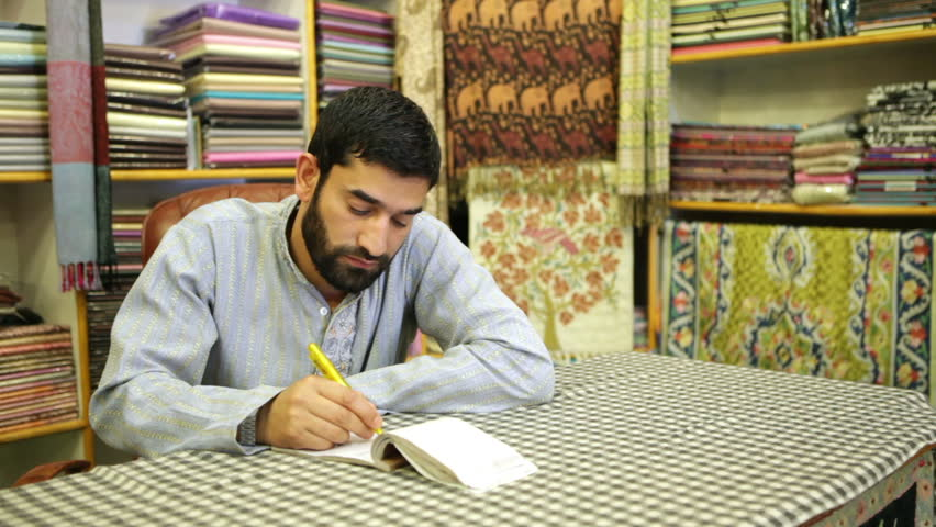 Asian male beauty. Seller of Pashmina originally from Kashmir.