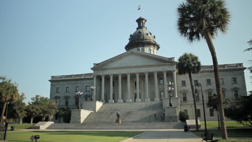 The South Carolina capitol building in Columbia. Daytime wide shot exterior of front view from Gervais St. With tilt up. - HD stock footage clip