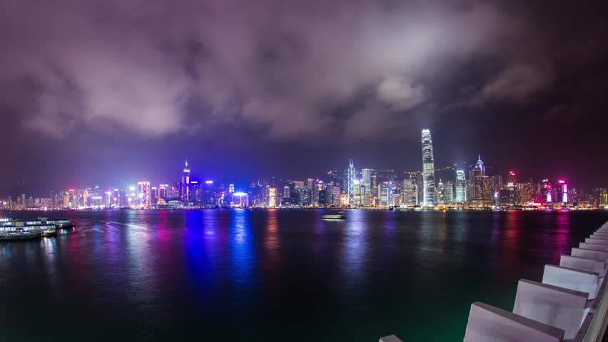 HONG KONG - CIRCA DECEMBER 2012: Time Lapse of cloudy night at Victoria Harbor in Hong Kong. Photo Sequence shot on DSLR camera and Post-Production in After Effects
