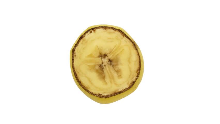 Timelapse of banana slice over white background