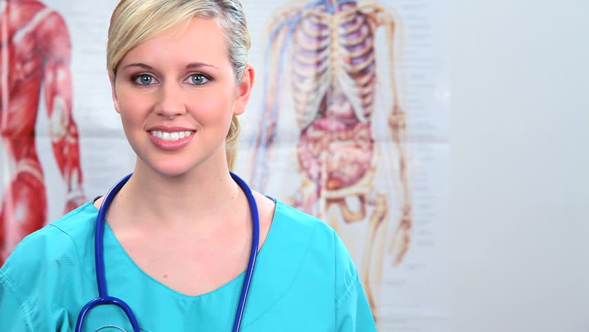 Young female medical student training in clinical healthcare - HD stock footage clip