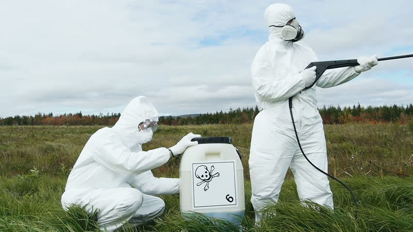 Two men in protective workware spraying toxic gas in the atmosphere _conceptual_