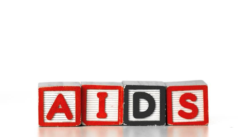 Blocks spelling HIV falling on blocks spelling AIDS in slow motion - HD stock video clip