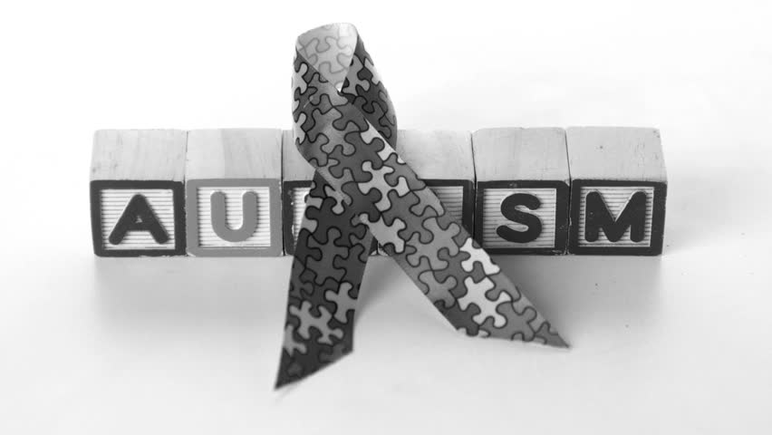 Awareness Ribbon Falling In Front Of Autism Letter Blocks ...