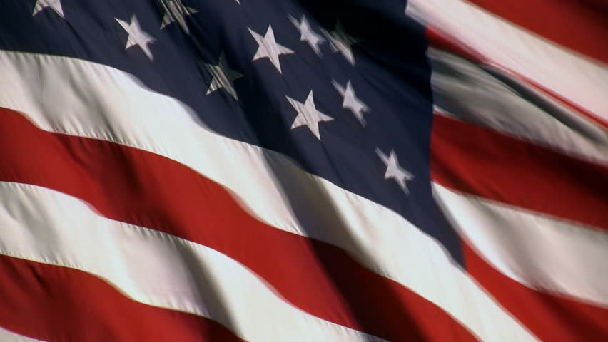 A real American Flag waving. Some blue sky shows through at times. - HD stock video clip