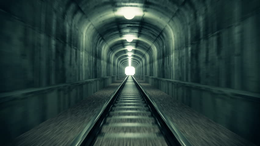Take a ride through old-looking rail tunnel with a light at the end. Can represent achieving your goals, getting through problems and obstacles or simply represent exactly what you can see - HD stock video clip