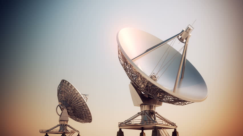 Satellite dishes rotating changing position in front of the camera. - HD stock footage clip