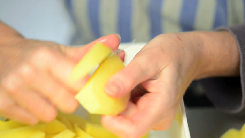 woman cutting fries - HD stock footage clip