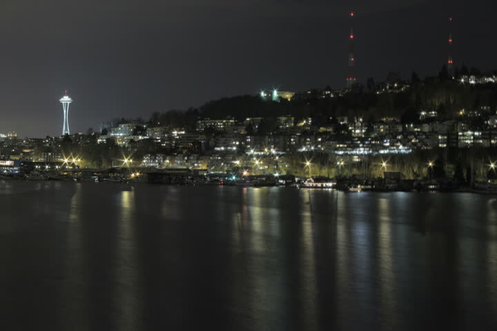 Lake Union docks with reflections in the water and Space Needle in the background. Shot as 4K (4096x2730) time lapse from Gasworks Park.