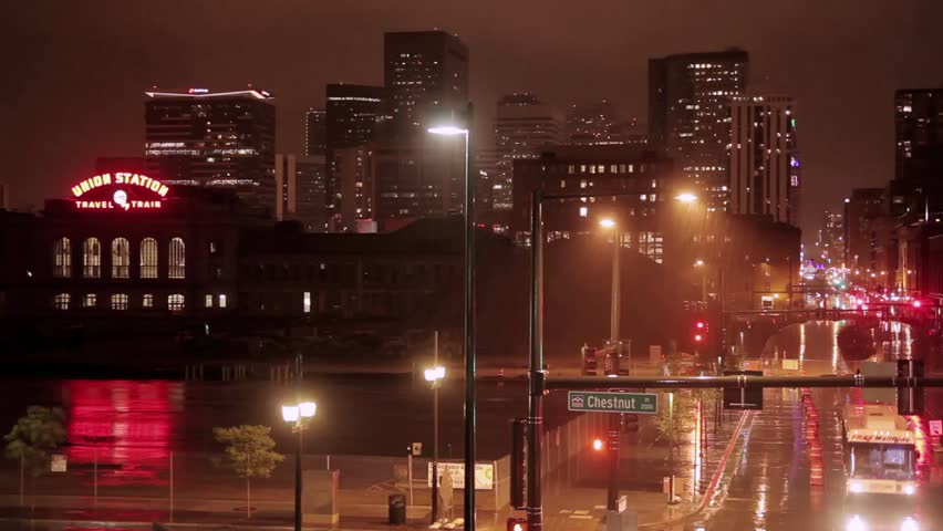 Night time timelapse of the intersection of Chestnut Place and 16th Street with Downtown high-rises in the background.