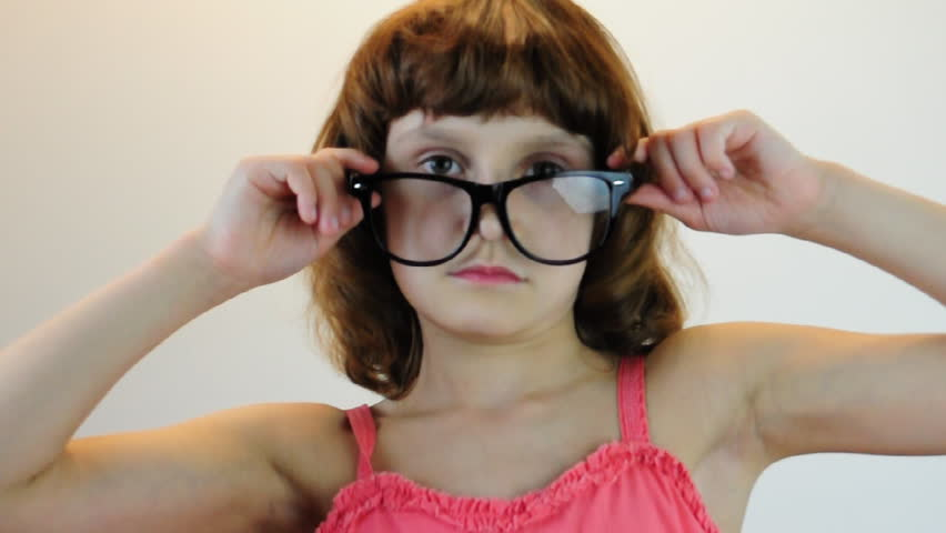 child plays with glasses and makes faces - HD stock footage clip
