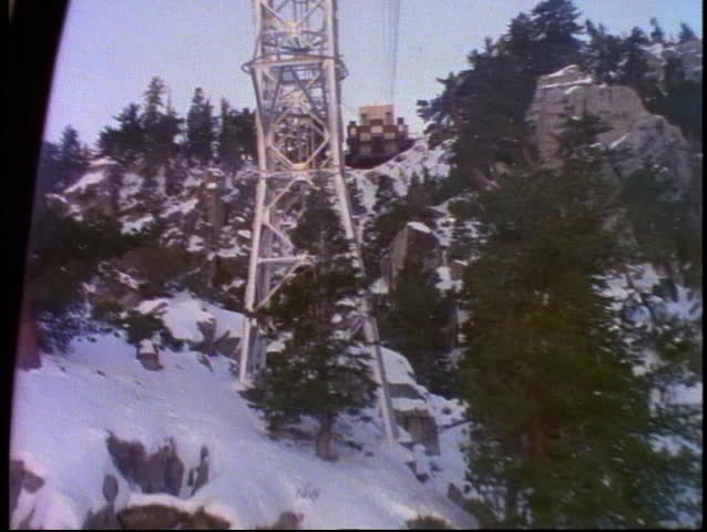 The Palm Springs Tram climbs up the snow covered mountains near Palm Springs