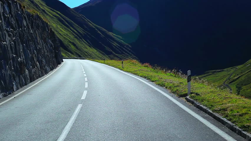 Road travel in Alps.