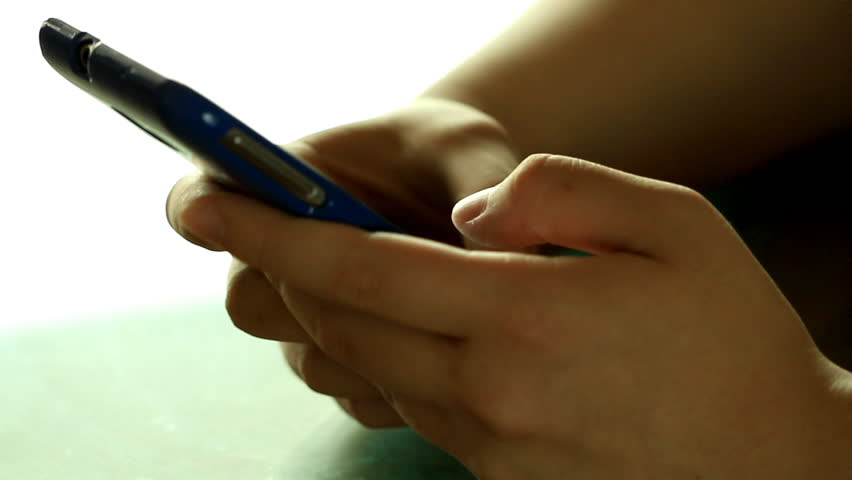 Hands typing fast text messages on smart phone