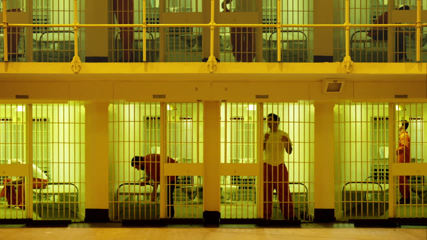 Prisoners serving time in a large cell block. Composite clip created by putting together six videos together with masking in After Effects.