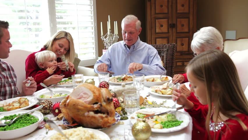 Camera tracks across table as extended family sit and for What do people eat on thanksgiving