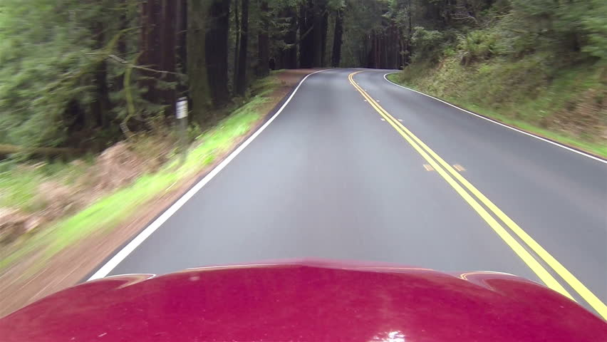 Driving California redwood passing rv and cars point of view. Left side of road driving. Vacation travel in vehicles along scenic byway and roads. Redwood National and State parks old growth trees. pov.  - HD stock footage clip
