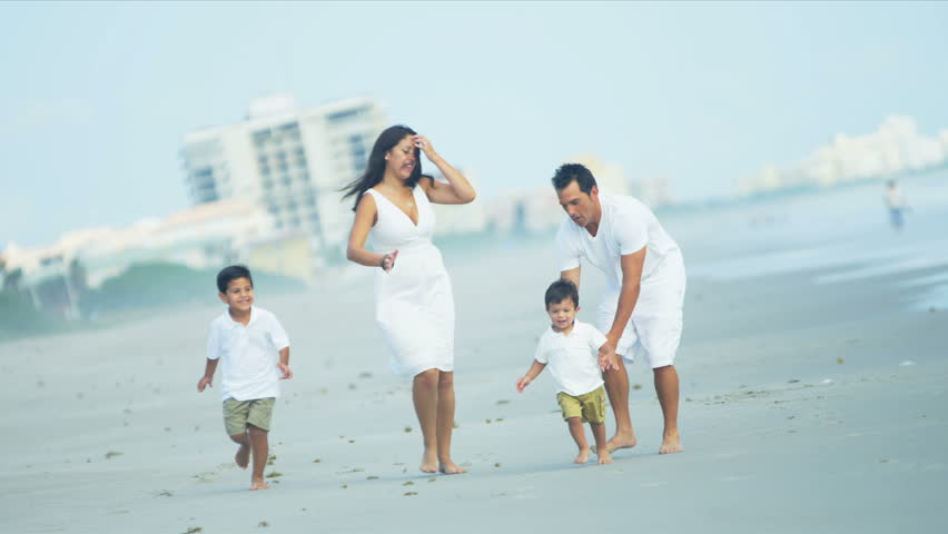 Loving Hispanic family spending summer holiday by ocean shot on RED EPIC - HD stock footage clip