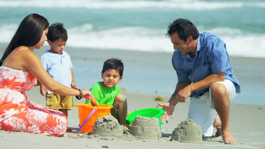 Loving Hispanic family spending summer vacation playing on sandy beach shot on RED EPIC - HD stock footage clip