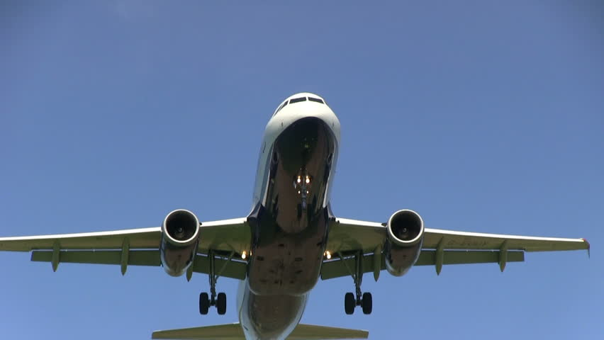 Airplane flying overhead - HD stock video clip