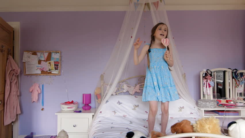 Little girl singing - dreaming of being a pop star - HD stock video clip