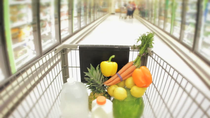 Shopping cart moving through supermarket aisles hidef hd healthy food in the basket  - HD stock footage clip