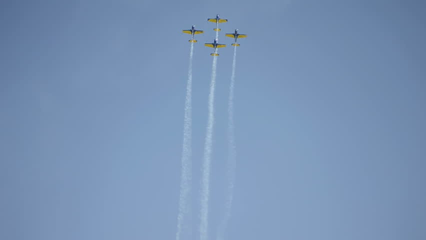"""CLUJ NAPOCA, ROMANIA - CIRCA MAY 2011 - Aerobatic stunt  planes from """"Aeroclubul Roman""""  in formation at Cluj Napoca Airport 70 year anniversary Airshow."""