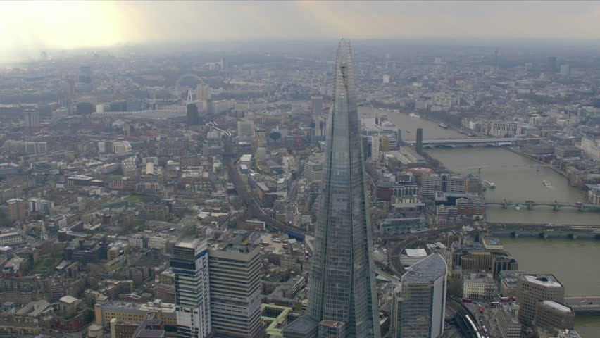 Panoramic aerial view of central London along the River Thames at dusk - HD stock video clip