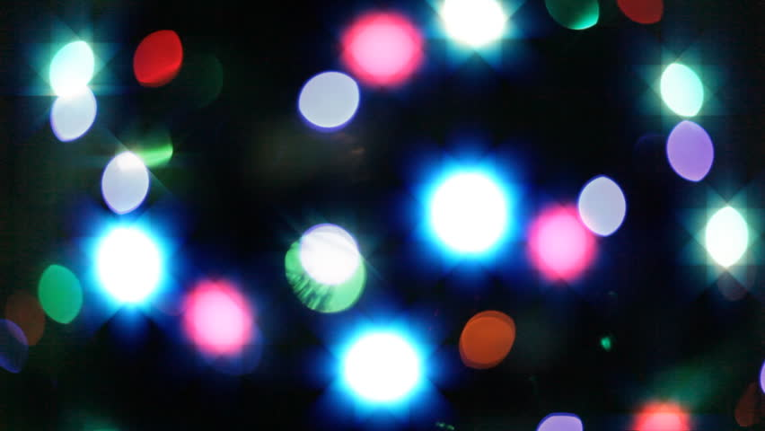 HD loopable video of blurred blinking Christmas lights.
