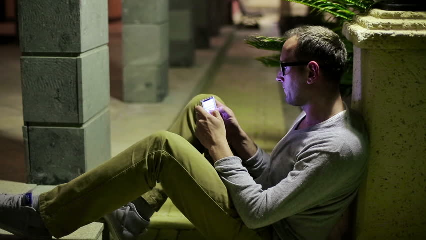 Young man using smartphone in the city