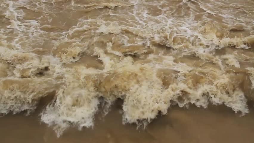 Torrent of muddy water. Rio on rainy days