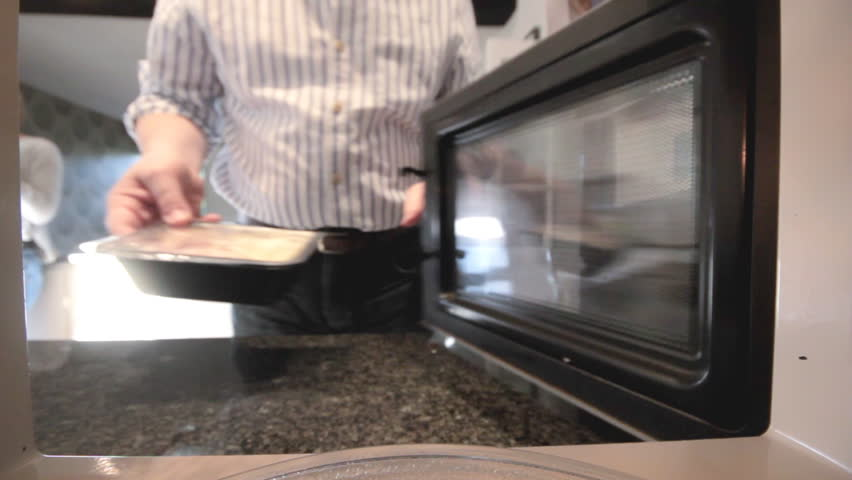 Putting ready meal in microwave - HD stock footage clip
