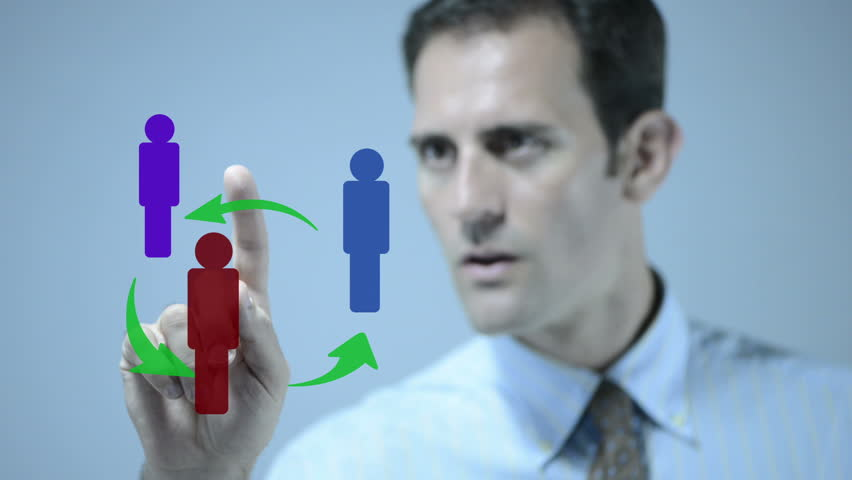 Man interacting with groups of illustrations on an interactive whiteboard. - HD stock video clip