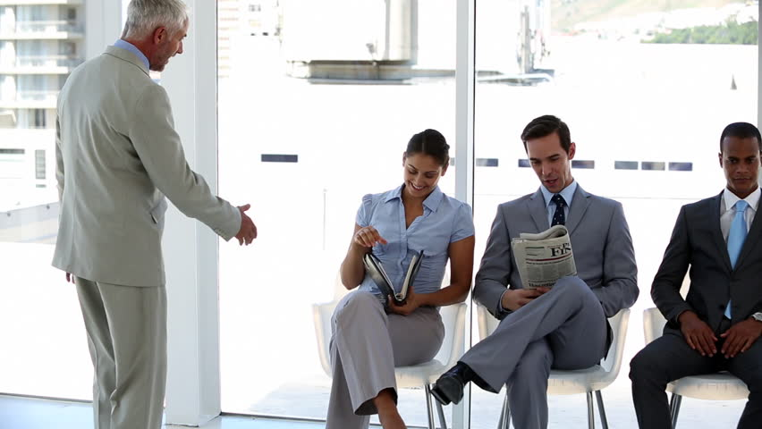 Businessman welcoming interviewee in the waiting room - HD stock video clip
